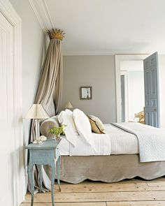 Love the grey-ey-taupe wall color with the antiqued blue accents and the neutral bedding.