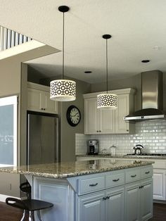 Love the subway tiles going up to the range hood. And the white cabinets...