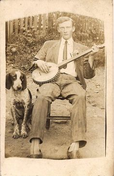 A hound dog and his banjo-playing buddy.
