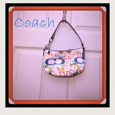 HOST PICK 3/14 Coach Hobo Multi Color Handbag ⛔️ REDUCED ⛔️ Was $70.  Now $60.  Authentic Coach small hobo multi color.  Used one weekend last summer. Trimming, straps and inside is baby blue.  2 coach tags (baby blue and silver on zipper). Hardware is silver. Small pocket on the inside.  Small black smudge on right upper backside (see pic). Coach Bags Hobos