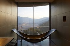 A carbon-fiber vessel tub mimics the form of a relaxing hammock, suspended above floor. From U.K. based Splinter Works...