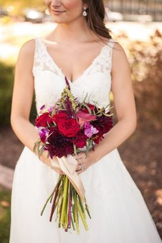 Red and purple bridal bouquet. Photo By www.mattkennedy.ca