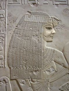 Lady in Waiting: detail of a limestone relief representing a festive gathering, in the tomb of the vizier Ramose at Thebes, New Kingdom, XVIIIth Dynasty, approx. 1400-1362 B.C.
