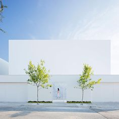 """The stark white surfaces that dominate this minimal house in Monterrey, Mexico, are interrupted by a golden wall that elevates the quality of light inside. Designed by Alberto Campo Baeza with @glrarquitectos, the home is named Domus Aurea – Latin for """"golden house"""". Find out more on dezeen.com/architecture #architecture #house #Mexico  Photography by Javi Callejas."""