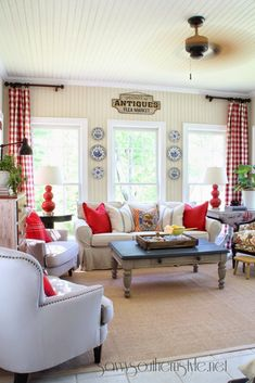 Savvy Southern Style: sun room, grain sack pillows, red buffalo checked curtains, #safavieh lamps, color