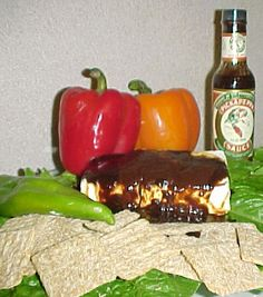 """This crazy photo is from Pickapeppa.com. The story, however, is a holiday ode to quirky appetizer """"recipes"""" from Southern tables. If you've eaten your fill of Cheese Crispies or PickaPeppa Sauce and Cream Cheese--and liked 'em, then you may be a Southerner, too."""