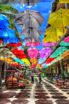 Le Caudan Waterfront in Port Louis - a great place to shop and eat! These colourful umbrellas create shade along the walkway. #portlouis #lecaudanwaterfront #beautiful