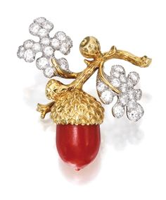 18 KARAT GOLD, PLATINUM, CORAL AND DIAMOND BROOCH, TIFFANY & CO. The coral acorn suspended from a textured gold branch, with leaves set with round diamonds weighing approximately 3.70 carats, signed Tiffany & Co.; circa 1969.