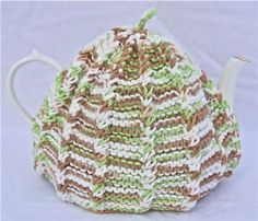 Knit Tea Cozy Cosy Handmade Washable Earth Tones by ChinaFind. $17.95. Gift Wrapping Available at Checkout. Soft, warm acrylic yarn in khaki, yellow green and winter white. Fits 5 or 6 Cup Standard Teapot. Knit in Rasised Rib Stockinette Stitch. Machine Wash and Dry. Lovingly hand knit in a soft washable yarn, this cozy will keep your tea hot and ready. It will fit either a five or six cup teapot. The flattering pattern keeps its shape well and washes up like a dr...