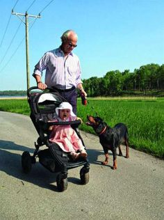 Princess Estelle of Sweden with her grandfather King Carl Gustaf and the family dog.