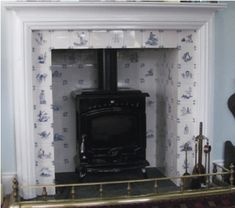 Delft tile fireplace surround Handmade tiles can be colour coordinated and customized re. shape, texture, pattern, etc. by ceramic design studios