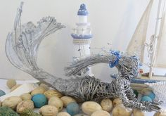 Check out this item in my Etsy shop https://www.etsy.com/uk/listing/268180533/mermaid-wire-sculpture-handmade