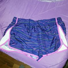 Running shorts Colorful purple running shorts with striped design. Rarely worn,size small. xersion  Shorts