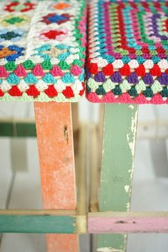 Love these afghan covered distressed wood stools!