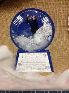 """""""If I lived in a snowglobe"""" class art project. So cute! Kids wore winter coat for photo and then put the pic behind a clear plate filled with """"snow"""": cotton, glitter and confetti!"""