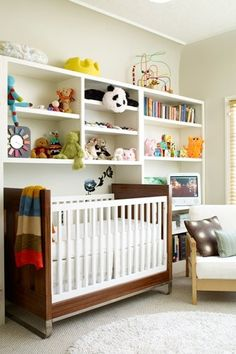 """""""These parents neatly turned an old office space into a nursery by putting the crib where a large desk used to be. Again, built-in bookshelves easily transform from holding books to holding baby supplies.""""Photo: Courtesy of Apartment Therapy #refinery29 http://www.refinery29.com/living-archive-124#slide-3"""