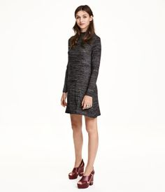 Short, fine-knit dress in soft mélange fabric with a mock turtleneck and long sleeves. Unlined.