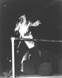 March 31, 1957  PHOTO: Elvis performing at the Olympia Stadium, Detroit, Michigan.