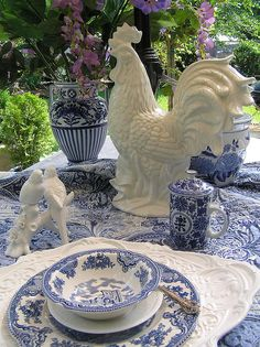 The bold rooster holding court and the lovebirds taking no notice on the blue and white colour scheme. JH
