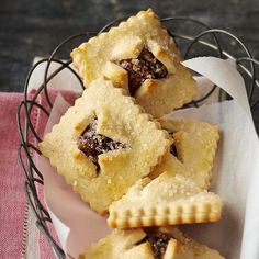 Italian Fig Bundles - A fruity blend of figs, dates, pine nuts, raisins, and cinnamon -- with a light citrus punch from orange zest and juice -- fills these soft cookie pockets. A star-shape cookie cutter and coarse sugar add a festive touch