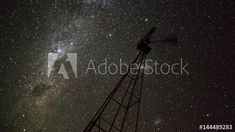 Stock Video of Linear & pan night timelapse of a silhouette Windmill frantically blowing in the wind against the Milky Way in a dark night sky with a reverse focus pull from out of focus to in focus at Adobe Stock Out Of Focus, Dark Night, Milky Way, Windmill, Stock Video, Night Skies, Geology, Stock Footage, South Africa