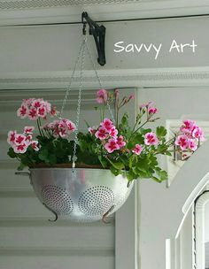 """Metal Colander Hanging Planter ~ Re-purpose a vintage metal colander into a hanging planter! I used a 1950's 12 inch metal colander, drilled 3 holes near the rim to insert 1/8"""" quick links, attached the chains and hung with an """"S"""" hook. (all hardware bought at Home Depot)  I also bought a plant basket coco liner for non-drips. I think the pink geraniums make this look so pretty! :-)  Like my Facebook page to follow my ideas, follow me on Instagram!"""