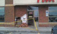 Someone created their own drive-thru at Tim Horton's.  I guess the regular line was too long.
