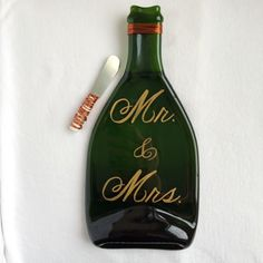 A personal favorite from my Etsy shop https://www.etsy.com/listing/250765516/mr-and-mrs-champagne-bottle-melted-flat