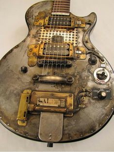 Some guy in Australia is making these steampunk guitars and I WANT ONE!!!