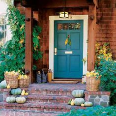 This blue front door is an unusual choice for a wooden home but fits into the landscaping beautifully