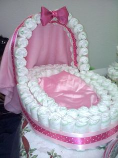"Diaper cradle centerpiece @Angela Gotchall I think we should do this instead of a ""cake"" this could be our cake. and fill the 