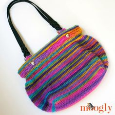 Show of your crochet skills and gorgeous yarn in the Boardwalk Bag - a FREE crochet pattern on Moogly!
