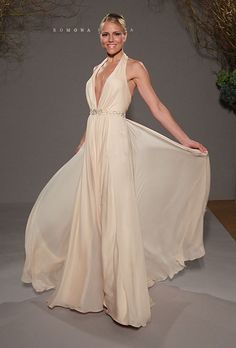 Brides.com: . Gown by Romona Keveza