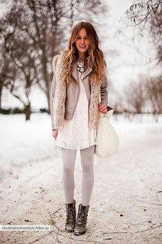 White lace dress, light grey leather jacket, light grey tights, black boots, silver jewelry