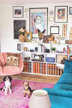 Bright vintage pink rug meets its match with a blue velvet sofa in this space that is not afraid to be bold. Eclectic gallery wall mixes art prints, photographs, and objects in an eye-catching way. Blue Velvet Sofa Living Room, Bold Living Room, Pink Velvet Sofa, Pink Couch, Living Room Decor Colors, Eclectic Living Room, Rugs In Living Room, Pink Rug, Eclectic Gallery Wall