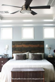 A simple, rustic headboard to give a bedroom a focal point.  It's boards cut to size and screwed into the wall.  Pick your stain, make it your own.  Easy peasy.
