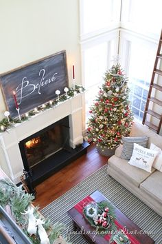 Modern-Farmhouse-Christmas-Decorating I really love the idea of a chalkboard on the mantle with a Christmas message on it.