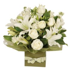 An elegant all-white flower arrangement of roses, gerbera daisies, and seasonal blooms in a basket. White Floral Arrangements, Flower Arrangements, White Roses, White Flowers, Online Flower Delivery, Altar Decorations, Wonderful Flowers, Woodland Wedding, Gerbera