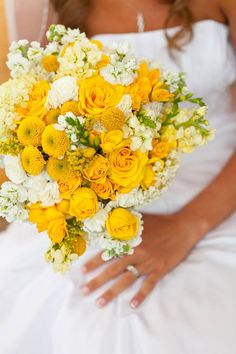 Summer Spring Wedding Bouquets made with Hydrangea, Roses, Buttons, Freesia, Stock, and Billy Balls (Craspedia)