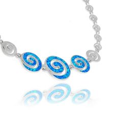 A sterling silver necklace featuring Circle of Life links decorated with three larger ones in the middle with blue opal inlay. Symbol of the eternity of all things in the universe and the cyclical nature of life, the contrasting polished silver with the vibrant blue colour of the opal stone will not fail to impress. This unique and inspired design combines the symbol of eternity with the eternal blue colour of the Greek summer sky.