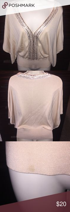 Beautiful Bebe Sweater top, sz Small Beautiful embellished tan sweater top by Bebe, sz Small. One small mark towards the bottom of the shirt as pictured. bebe Tops