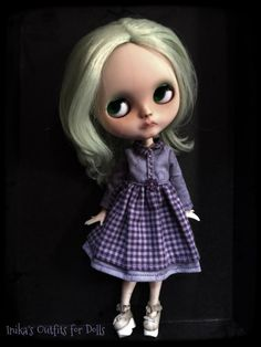 Cotton dress for Blythe in purple color.  The dress has two small snap buttons closure on the back.  The doll stockings and shoes are not included.  It a product made by hand.  Is not expected to return.