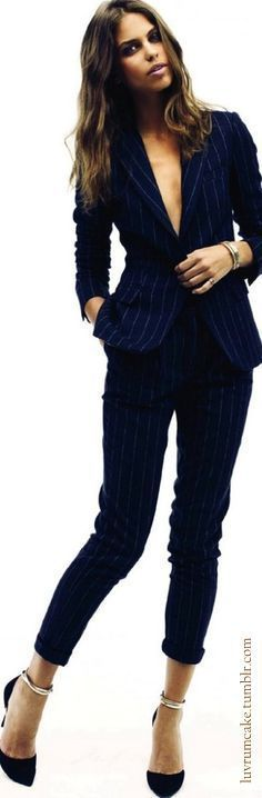 Fitted navy blue pin stripe suit