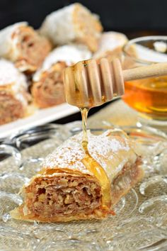 Sweet and flaky this easy rolled Russian Baklava will melt in your mouth! Phyllo dough nuts and sugar never tasted so good! The post Easy Rolled Russian Baklava appeared first on Dessert Park. Best Dessert Recipes, Fun Desserts, Sweet Recipes, Delicious Desserts, Snack Recipes, Phyllo Dough Recipes, Pastry Recipes, Baking Recipes, Russian Desserts