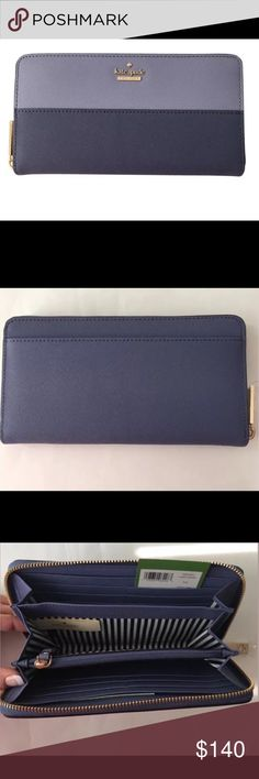 Kate Spade Cedar Street Lacey Wallet Blue/Oyster Saffiano Leather Wallet Clutch New with tags $178 and care card Color: Smoke blue/oyster The wallet features twelve credit card slots, two billfolds, a change pocket and an exterior slide pocket to house any of your odds and ends. cross-hatched saffiano leather with matching trim 14-karat light gold plated hardware custom woven jacquard with dots lining zip around continental wallet 12 credit card slots, 2 billfolds, zipper change pocket and…