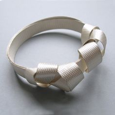 Antonella Giomarelli - Strap bangle. I like the ribbon effect and simplicity.
