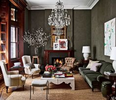 Asymmetrical mantel arrangement and lamp placement, etc. jessica-chastain-carrier-and-company-AD-habituallychic-002