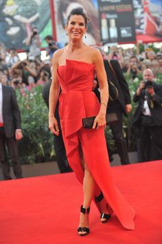 Sandra Bullock in a red strapless gown by J. Mendel at the Venice Film Festival #fashion