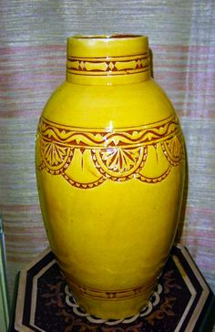 Carved Mustard Vase - $65.00  Made from Moroccan red clay, our ceramic flower vase is hand-thrown and carved by seventh generation potters from Safi.    Measurement: 17in H x 10in W Carving design may vary. https://treasuresofmorocco.com/shop/?slug=product_info.php&products_id=181