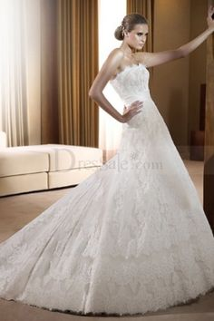 Ivory Royal Empire Bridal Dress Features Delicate Lace and Ribbon